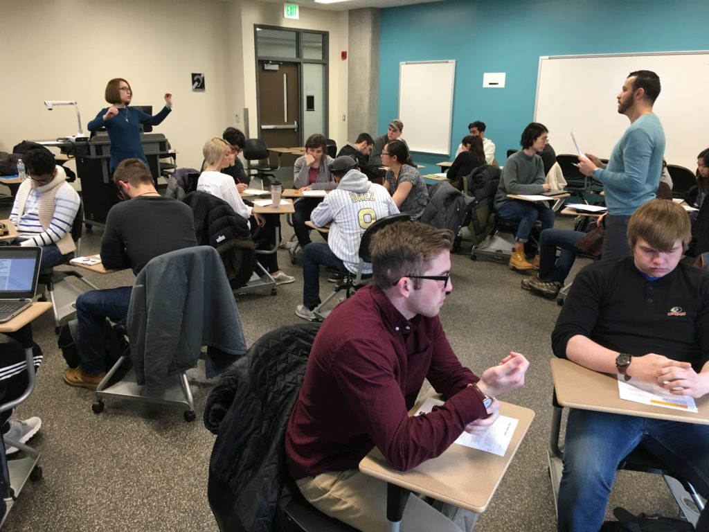 Rebekah Sims and Hadi Banat Team-Teaching, Spring 2018. Photo includes a classroom with students.