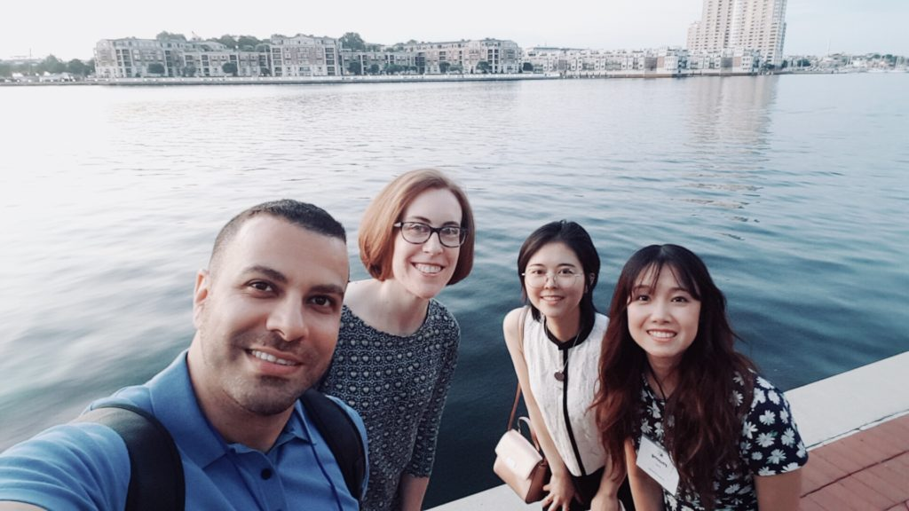 Team by the water in Baltimore, MD. From left: Hadi, Rebekah, Echo, Phuong.